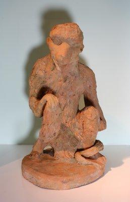 Beeld terracotta aap